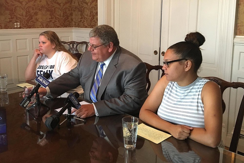 Amanda Tucholski, at left; John Mizner, at center; and Bryhanna Manus, at right, held a news conference Monday, July 2 to share their reactions to newly released surveillance video footage showing Felix Manus at the Erie County work-release center on May 30. Mizner is the lawyer for the Manus family. [MADELEINE O'NEILL/ERIE TIMES-NEWS]