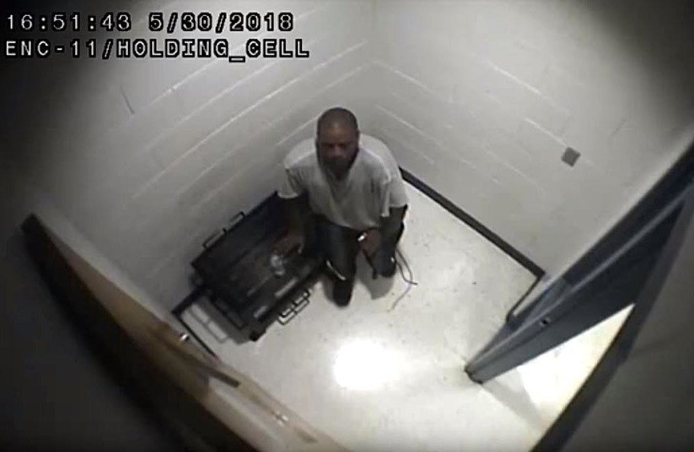 This is a screenshot of surveillance video footage taken from inside a holding cell at Erie County's work-release center. Footage provided by Erie County shows the minutes before inmate Felix L. Manus received medical care on May 30. The lawyer for the Manus family charges that corrections officers delayed calling 911 after Manus suffered an asthma attack during a work-release detail near Edinboro. [CONTRIBUTED PHOTO]