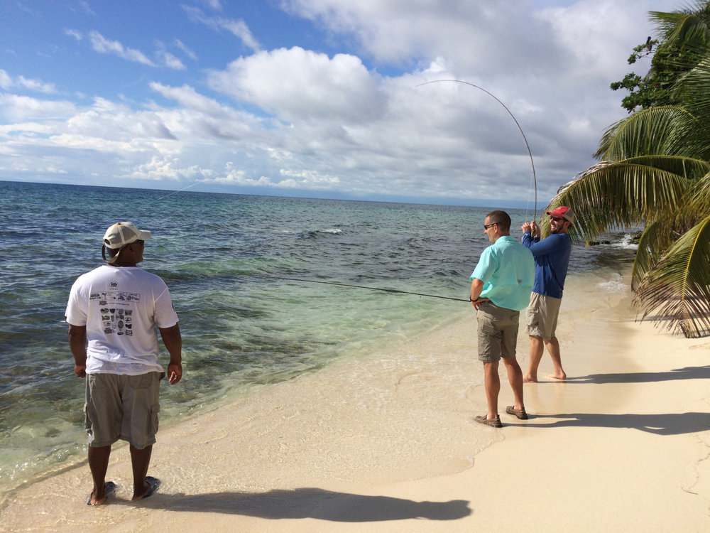 Bonefishing in Belize at the 2015 Gene Families & Isozymes Meeting with, from L-R: our guide, Polo, Jon Oatley (Washington State University), and Chris Geyer (East Carolina University).