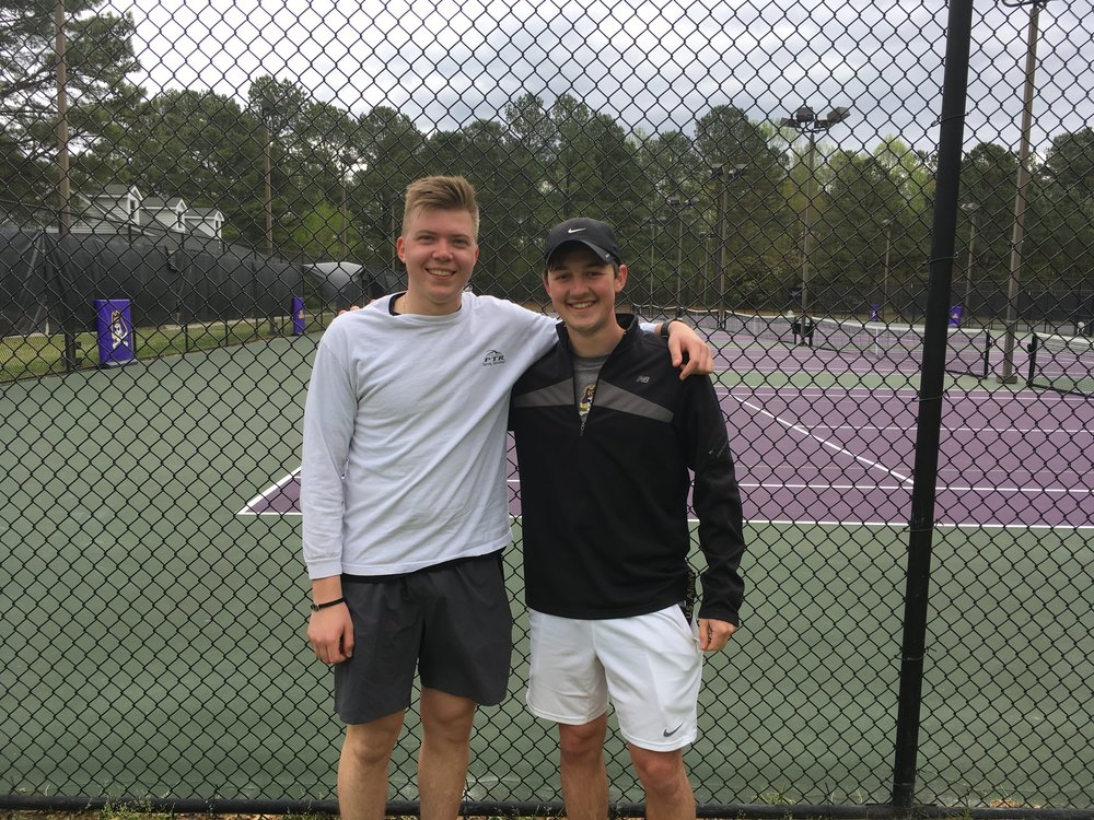 The lab took a morning field trip in April 2017 to the ECU tennis courts to eat Duck Donuts and watch our two tennis superstars battle it out. Pictured, from L-R: Sasha Kirsanov and Trey Cook.