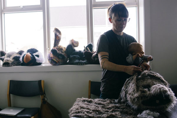 Crocheting, with four week old Atticus in the sling, during Saga Fest Artist Residency in Iceland