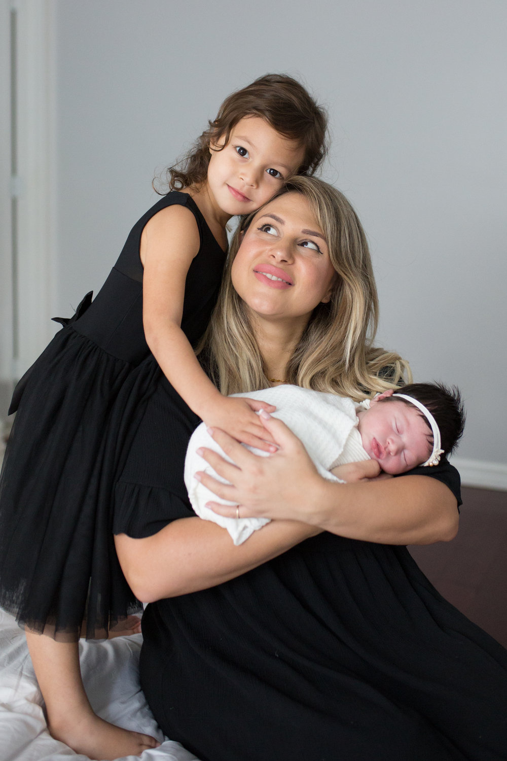 mom with newborn and toddler photo