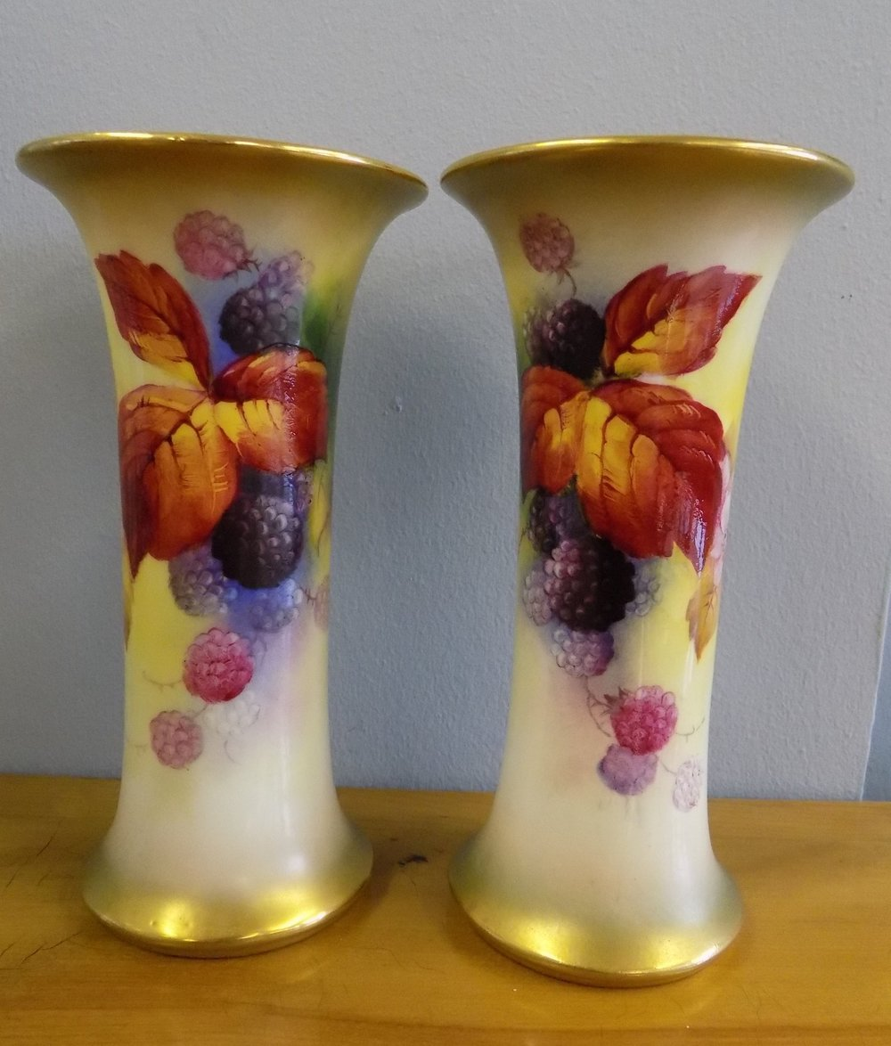A pair of Royal Worcester vases by K. Blake dated 1934 £480.00