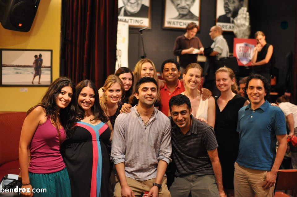 Big group of friends at Story League at Busboys and Poets DC, with host   Dave Hill   signing his book onstage in the background (Photo:  Ben Droz )
