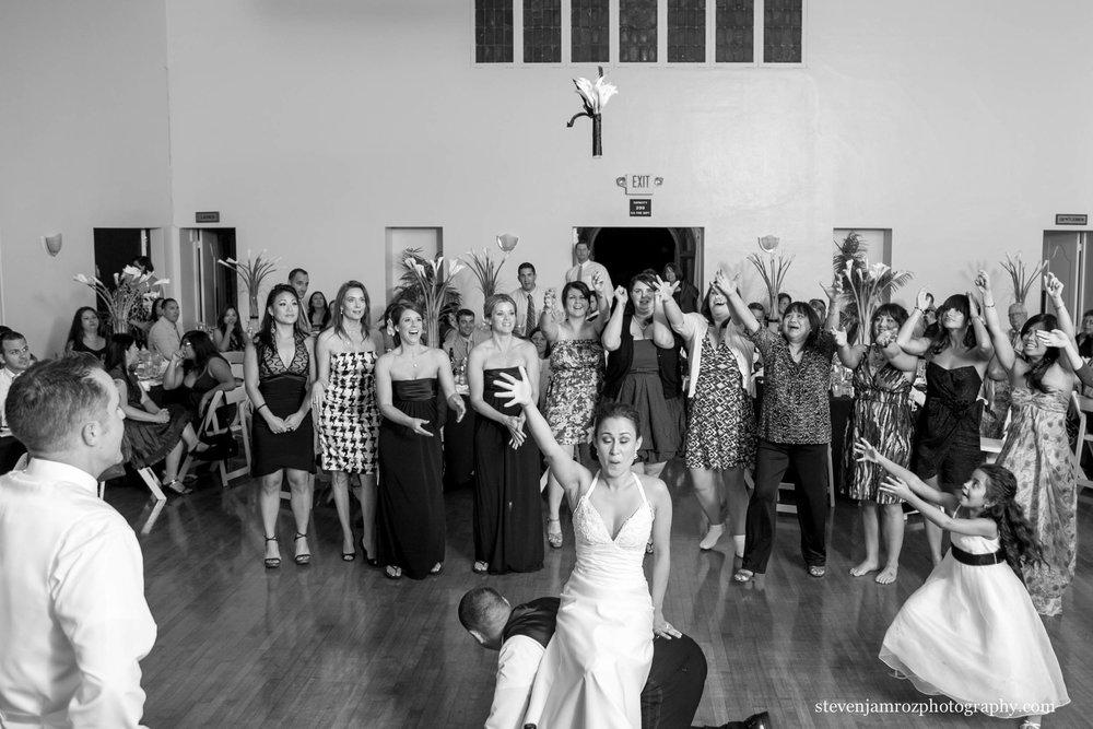 bride-sitting-on-groomsman-toss-wedding-steven-jamroz-photography-0480.jpg
