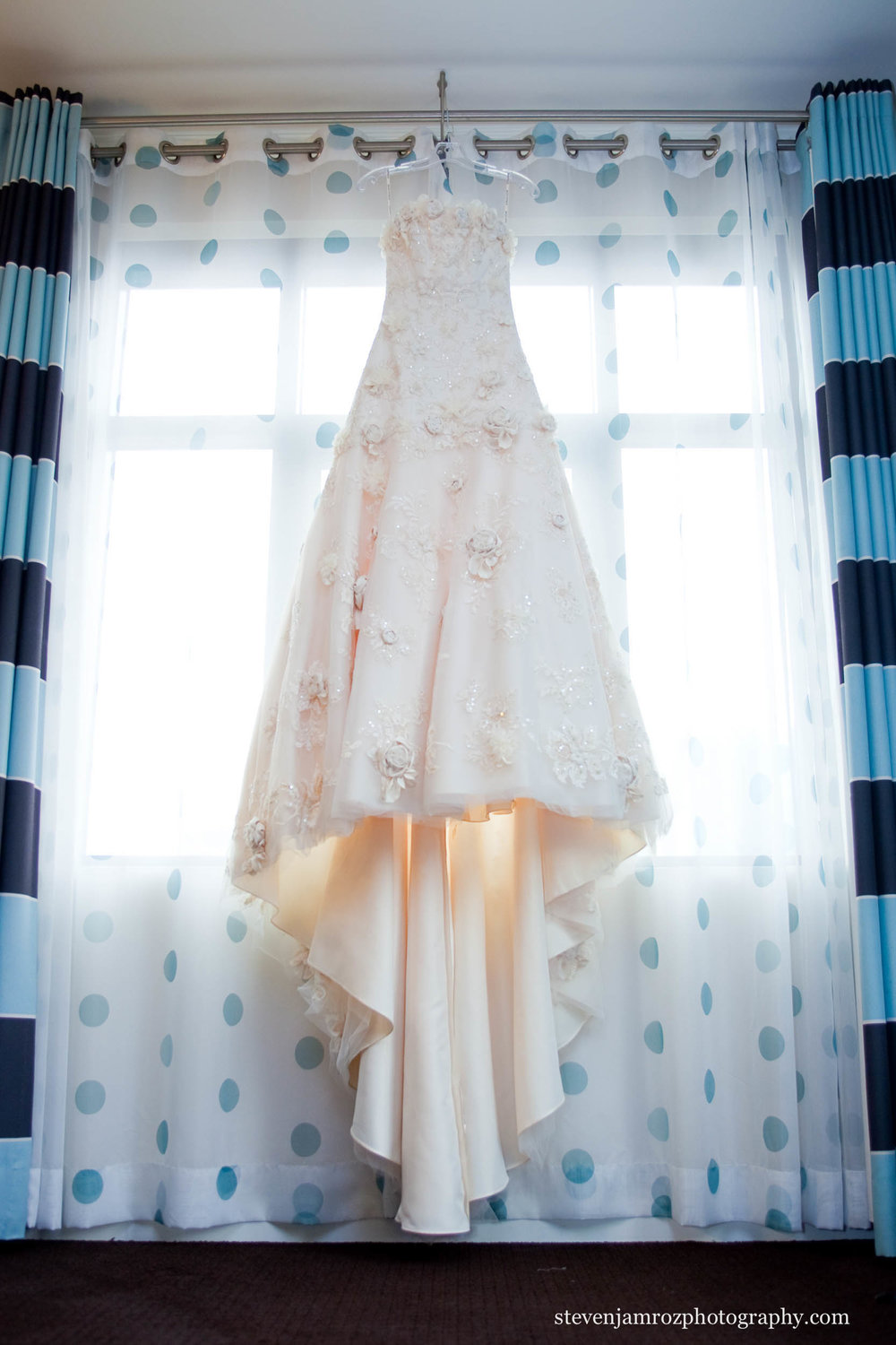 dress-hanging-in-window-wedding-raleigh-steven-jamroz-photography-0228.jpg