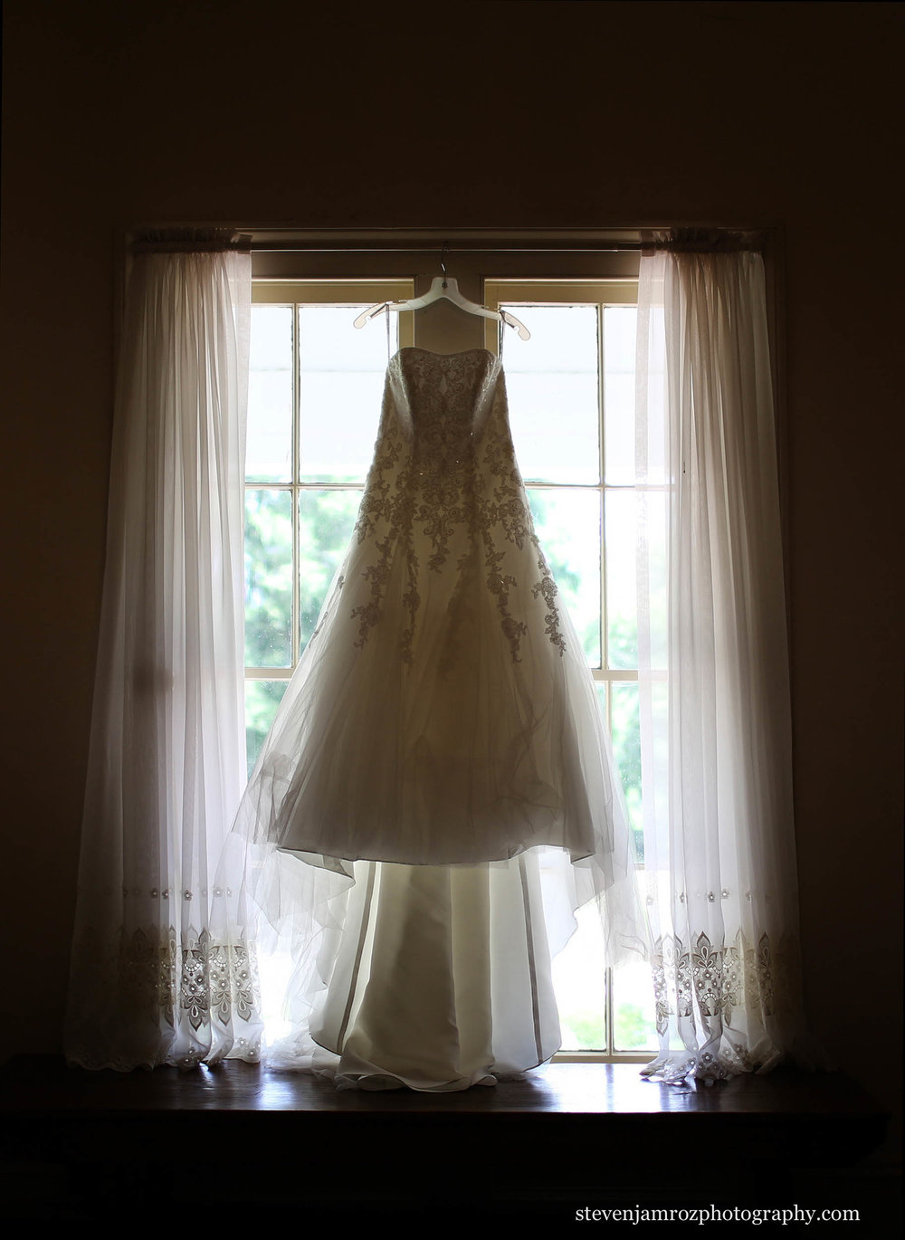 dress-hangs-at-rose-hill-plantation-nc-wedding-0794.jpg