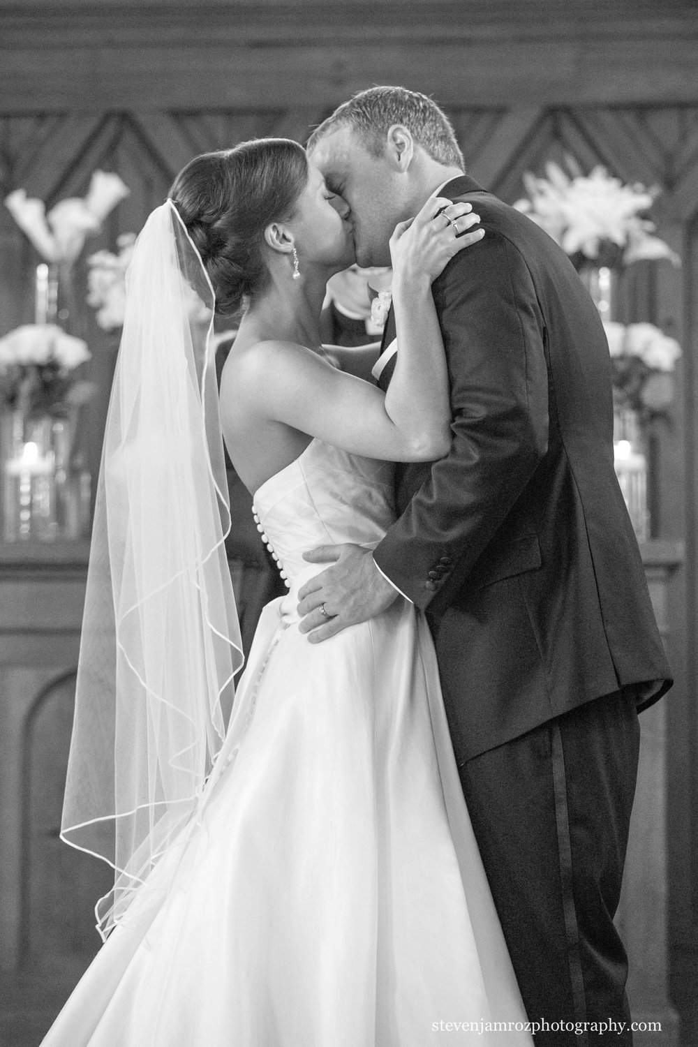 married-kiss-all-saints-chapel-raleigh-steven-jamroz-photography-0385.jpg
