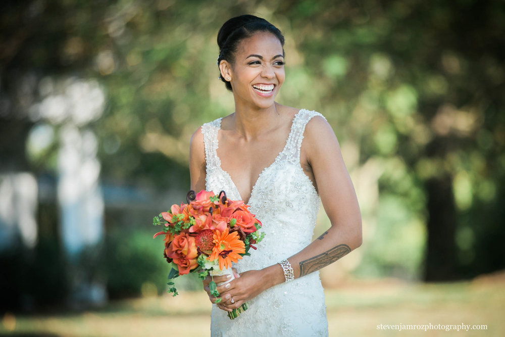 smiling-bride-holding-flowers-hudson-manor-nc-steven-jamroz-photography-0216.jpg