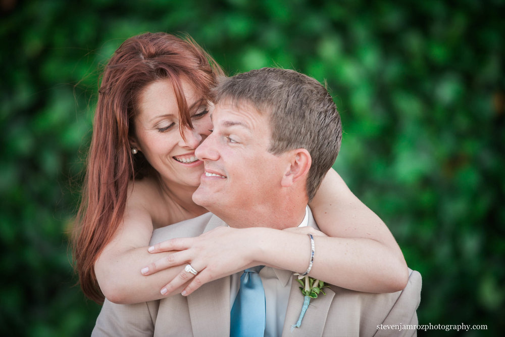 snuggling-bride-and-groom-raleigh-nc-0516.jpg