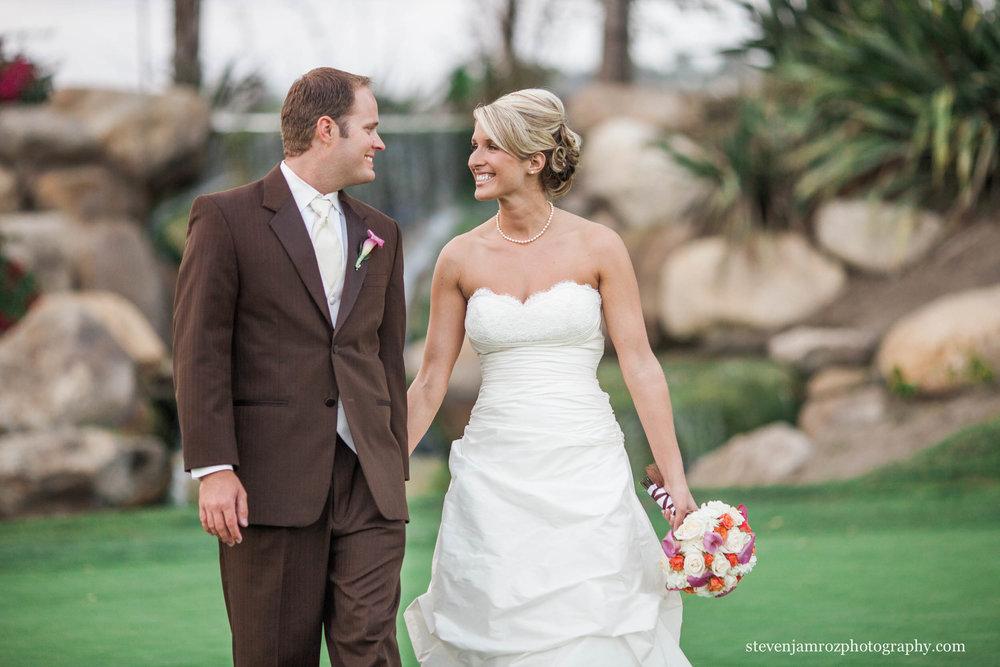 walking-bride-and-groom-brown-tux-raleigh-photographer-0520.jpg