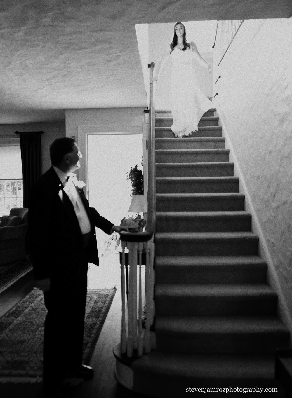 bride-comes-down-stairs-sees-dad-raleigh-wedding.jpg