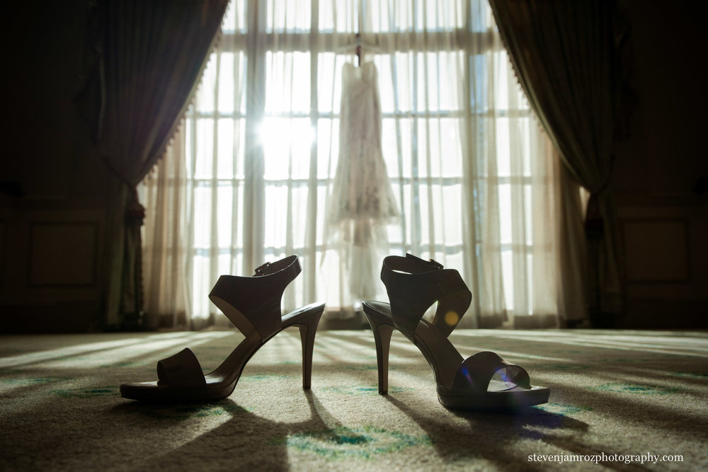 shoes and wedding dress-hanging-bride-gets-ready.jpg