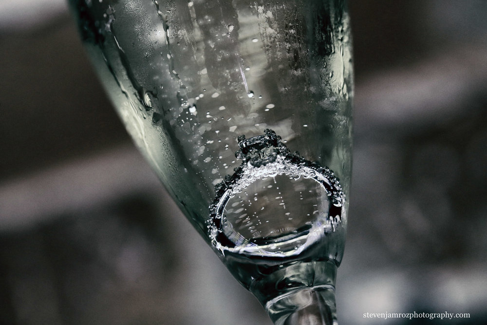 wedding-ring-in-champagne-glass-raleigh-photographer.jpg