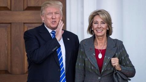 Ms. Devos with Tiny Handed Trump