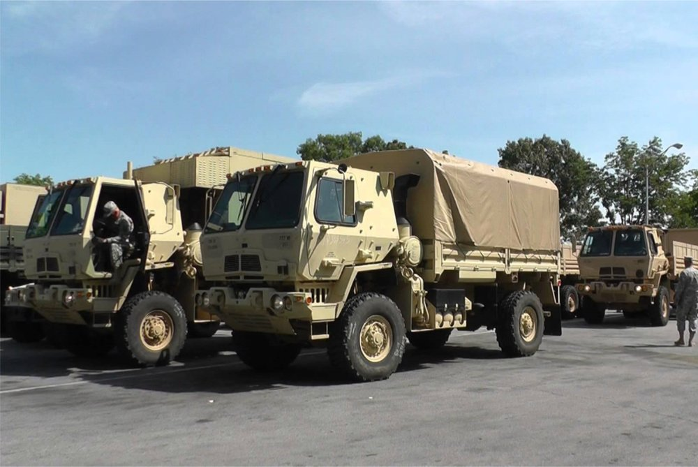 army trucks at a stop.jpg