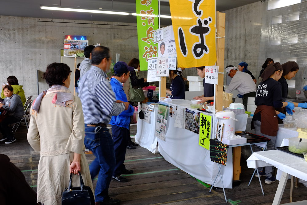 Festival-goers lining up for soba.