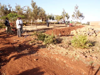 Mlimani classroom, Aug 2012 Soil breaking; getting ready for the foundation.
