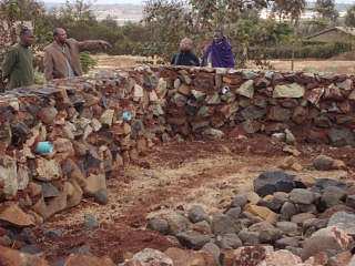 Mlimani classroom, Aug 2012 Inspecting the foundation.