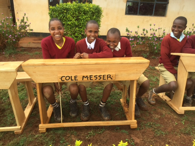 Primary students at Haymu School with a new desk donated in memory of Cole Messer