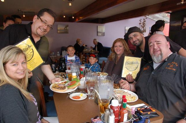 Photo by Horace Hinshaw  Breakers restaurant recently opened in Rockaway Beach. Owners Steve Bancroft (left) and Ray Geith, right, greet cutstomers (l-r) Michelle Blagrove, Fallyn Lucia, Paulie Lucia, Stacey Spalding and Rich Bacchi at a morning breakfast.