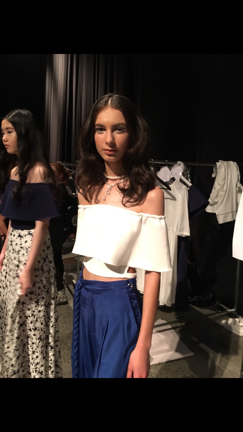 Behind the scenes at Rochelle runway show Models wearing Stella by TORY and KO Pearl Meteorite Limited Edition necklaces.png