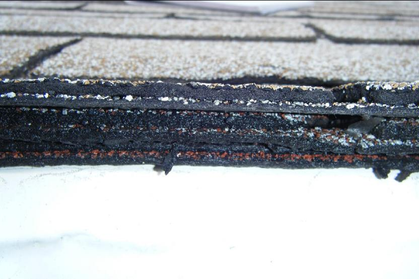 When it comes time to install a new roof, most homeowners will decide whether to have the existing shingles removed before installing new ones. Most jurisdictions limit the number of layers allowed on a roof, in most places, that limit is two or three layers. In some places, it's only one layer. Installing new shingles over old has some disadvantages: It will void any manufacturer's warranty. Shingles will dissipate heat more slowly, which will shorten their lifespan. Shingles may radiate more heat into the living space, increasing cooling costs. It adds extra weight and stress to the roof structure This photo shows 3-layers of asphalt shingles, I highly recommend removing all layers of old shingles before re-roofing, most good roofers will agree.