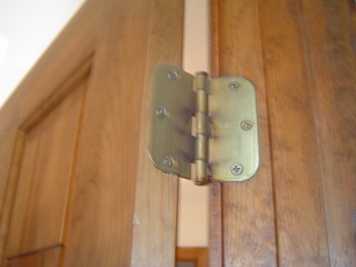 Have you ever had an interior door in your home that would not stay open or closed? The cause could be loose screws at the hinges, poor installation or settling of the home over time. First make sure the screws are all tight. If you still have an issue, remove 1-hinge pin and lay it on a flat cement surface and strike it with a hammer putting a slight bend in the pin. Then hammer the pin back into the hinge and your problem will be solved.