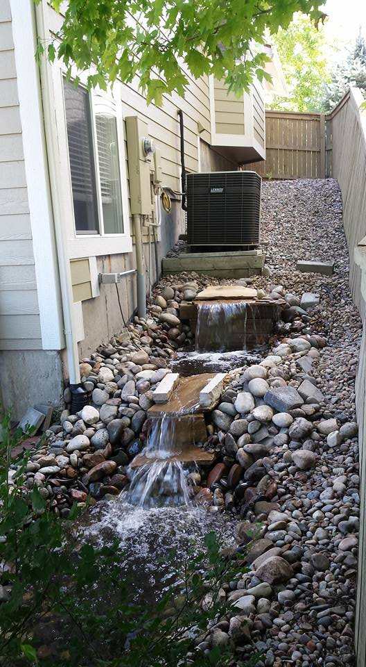 Nice looking stream in a very tight area between the fence & house which made the inspection of the A/C & electrical panel almost impossible - horrible planning here.