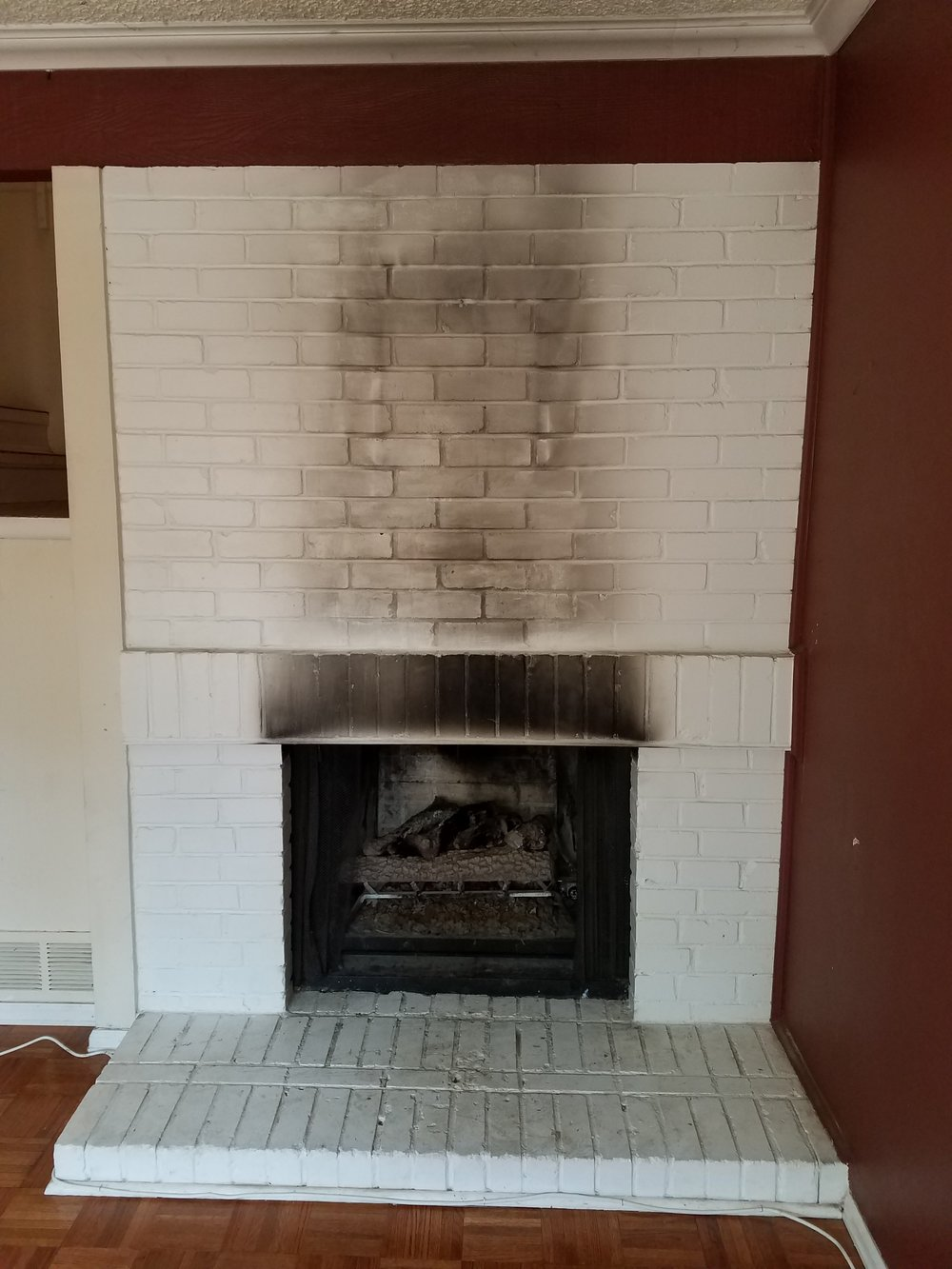 When a wood burning fireplace is converted to gas the damper must be blocked open or removed. Otherwise it creates both a fire and carbon monoxide hazard.
