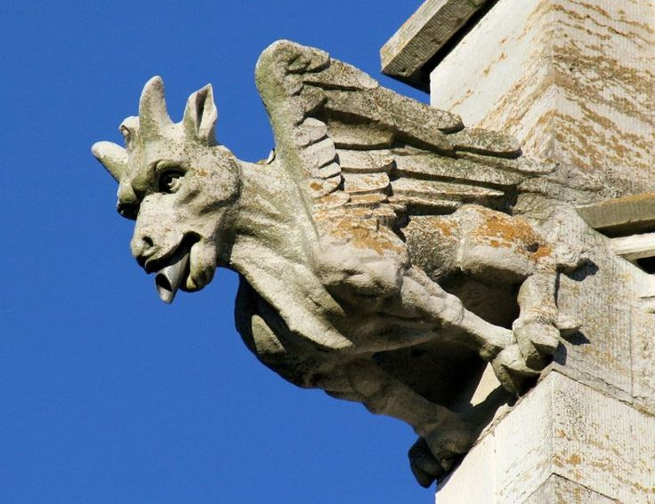 Gargoyles were originally designed with a spout to direct roof rain water away from the sides of a building, preventing the eroding of mortar at masonry walls. A trough is cut in the back of the gargoyle and rainwater typically exits through the open mouth. HAPPY HALLOWEEN!
