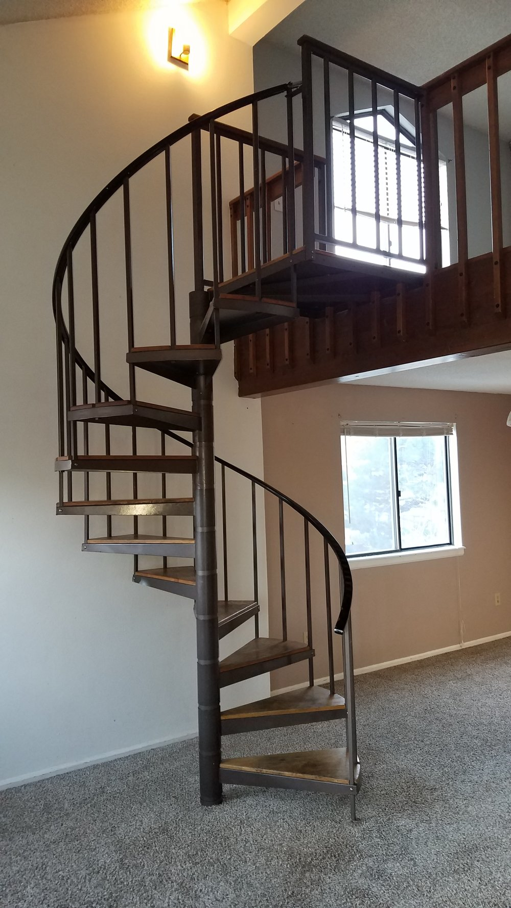 "Spiral staircases, open risers and balusters spaced more than 4"" apart are all potential safety hazard for small kiddos and pets. Also moving furniture up and down has got to be a nightmare."