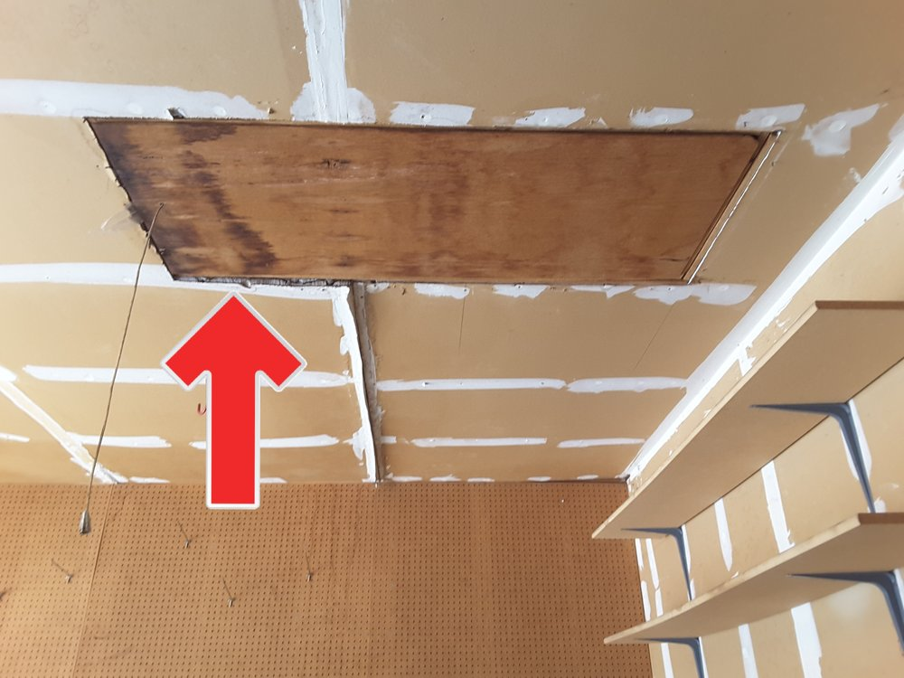 Garage pull-down attic stairs compromise the fire separation barrier. A common issue, especially when a garage was converted from a carport.