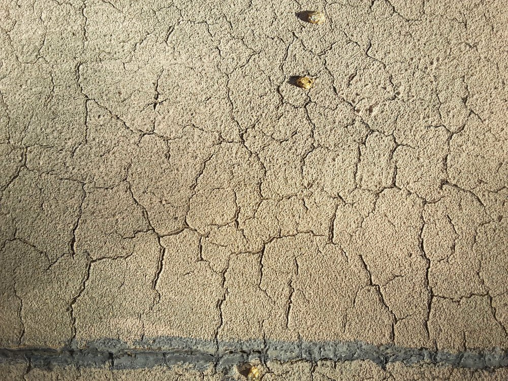 Asphalt roll roofing has a lifespan of about 5-10 years. Widespread craze cracking like this will soon result in leaks.