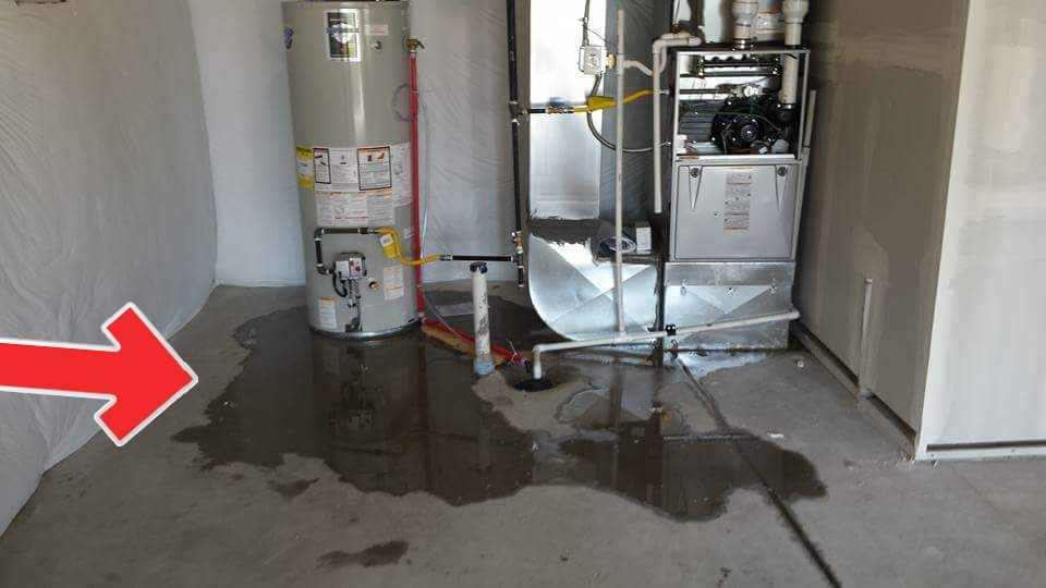 Leaking water heater? Nope! The condensate line from the A/C evaporator coil is leaking due to a poorly glued joint.