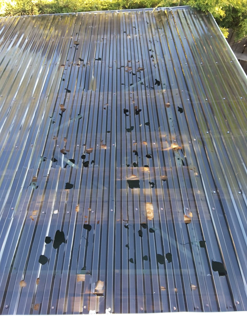 If your in an area that receives any hail, corrugated plastic is a horrible choice for a roofing material.