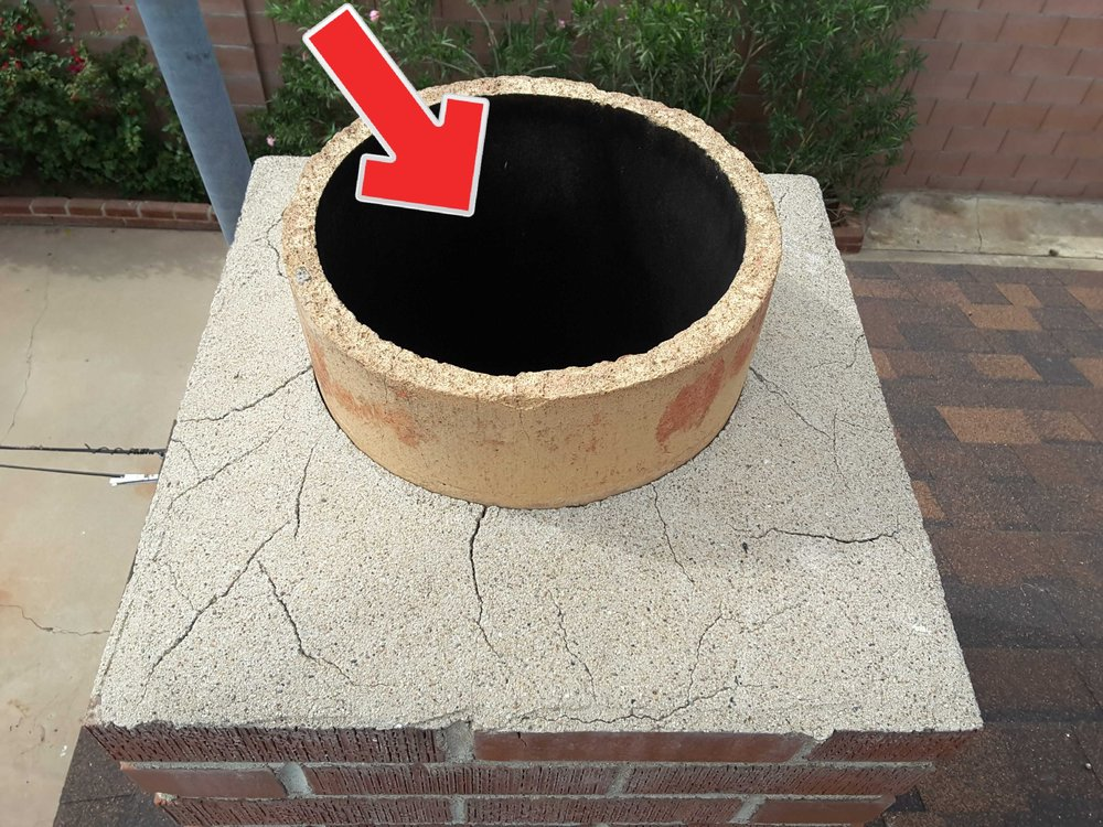 This chimney needs a screened weather cap, which acts as a spark arrestor and keeps rain and animals out of the flue pipe.