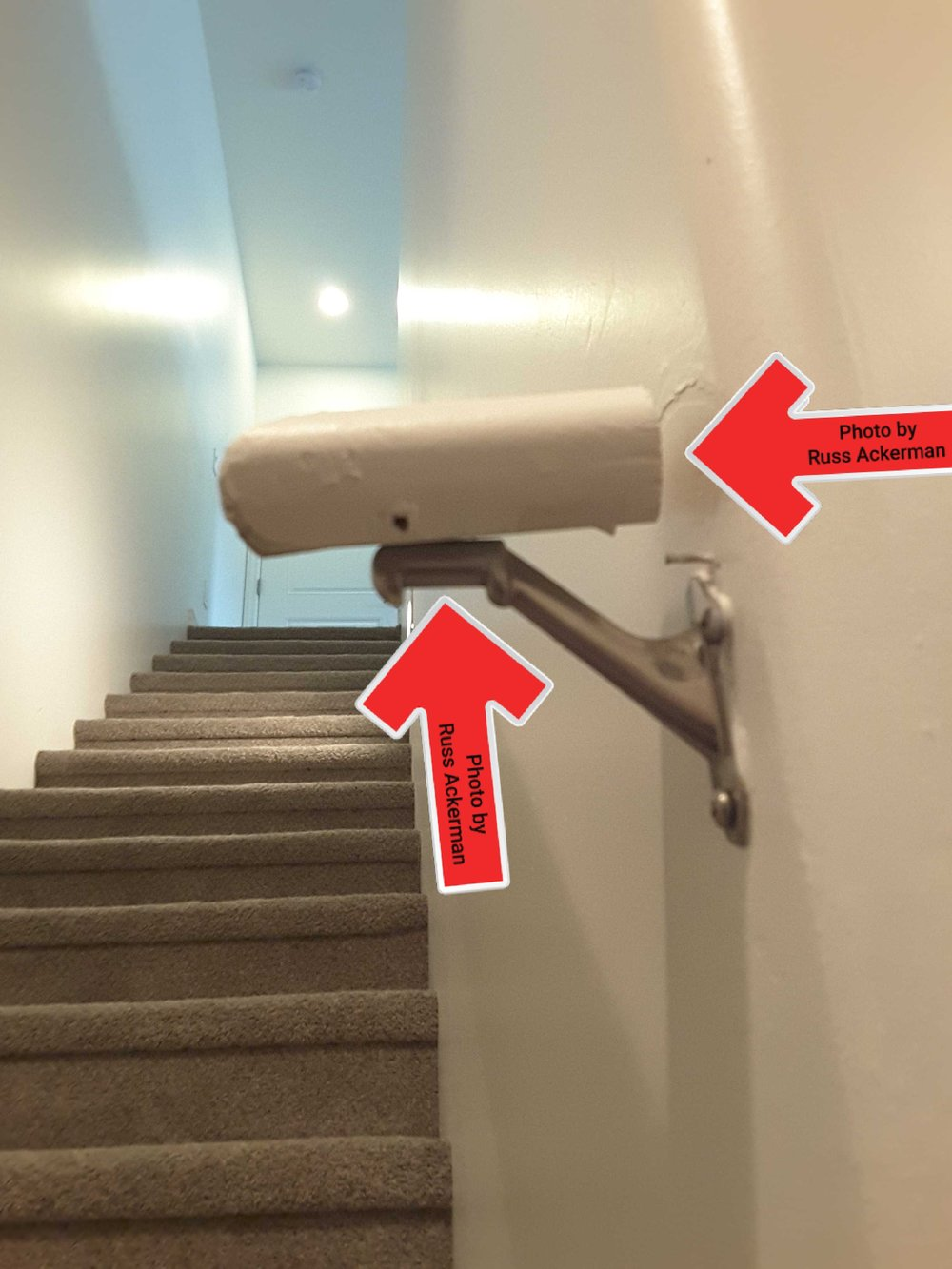 Loose basement handrail is a safety hazard. Replace the missing bracket under railing and problem solved.