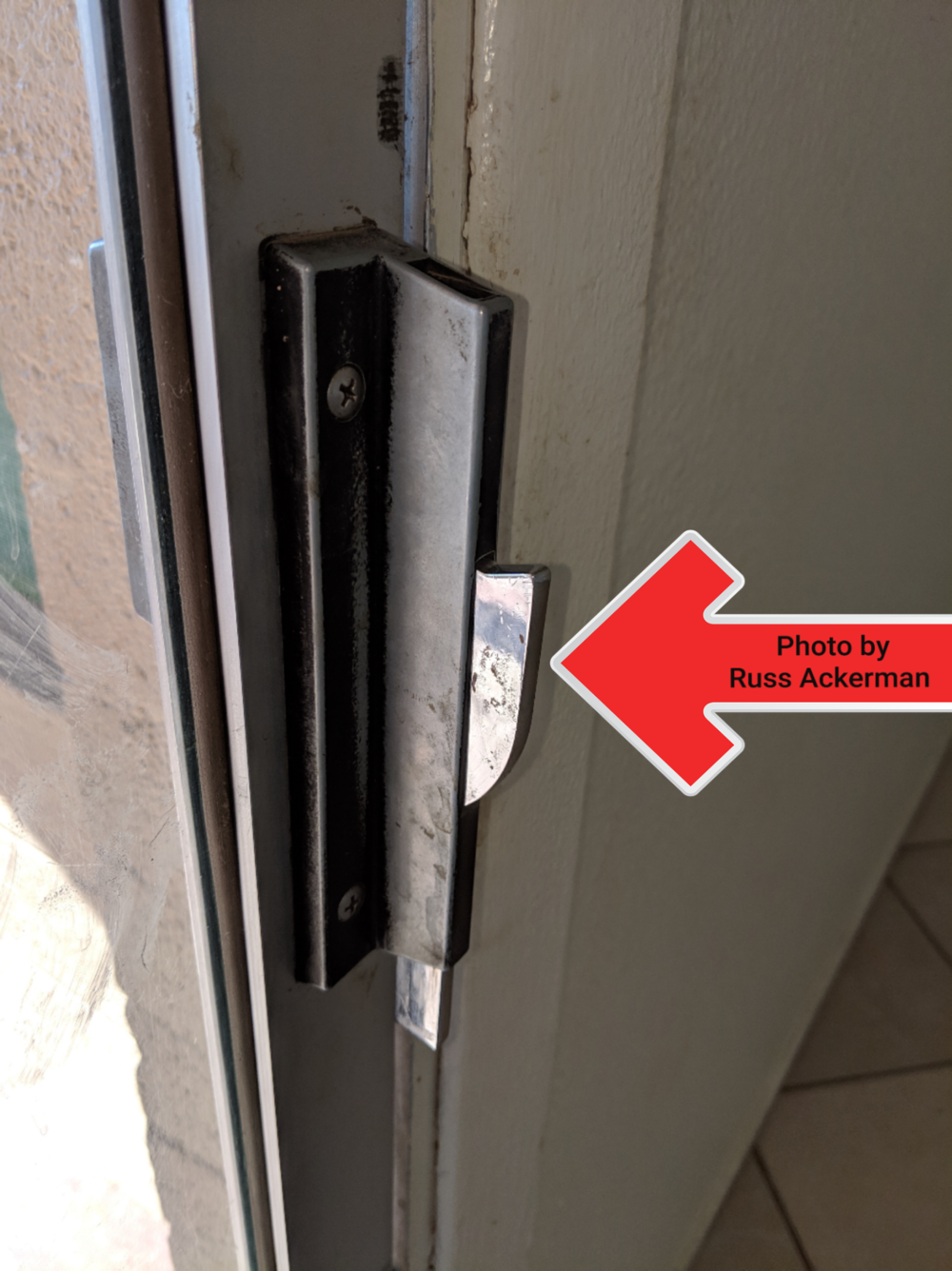 This old self locking patio door latch may lock you out of your home. Imagine that you're cooking or have an infant at home and you step outside for a minute. Hope you have a key.