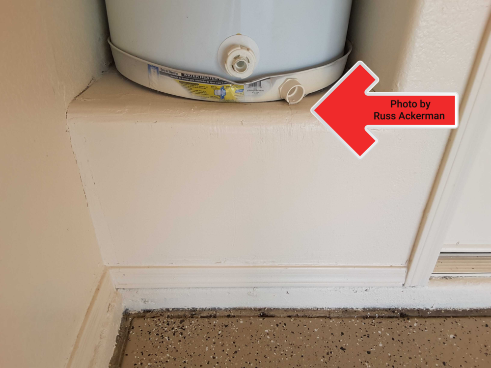 A pan under the water heater is great, however extending a drain line to the garage floor will reduce water damage should a leak develop.