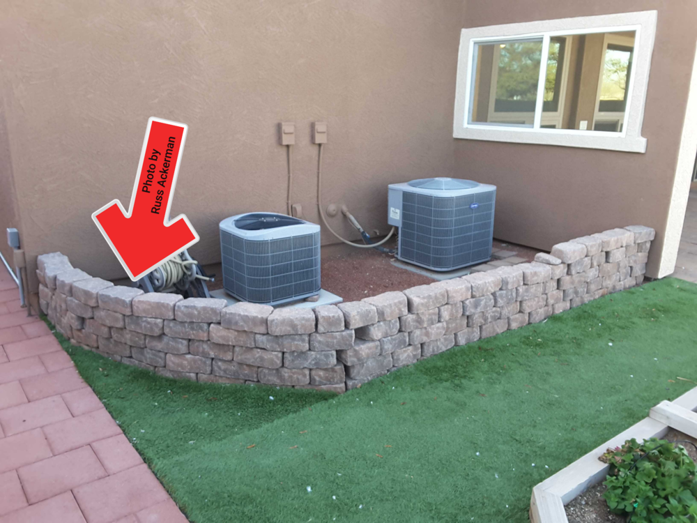 This makeshift retaining wall is a safety hazard if someone attempted to lean or sit on it. Removable is the best option.