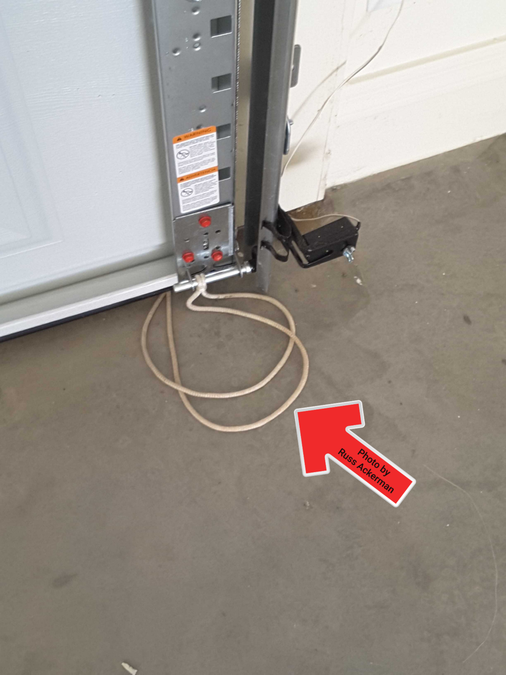 Overhead garage door pull strings will interfere with electric eyes preventing door from closing property.