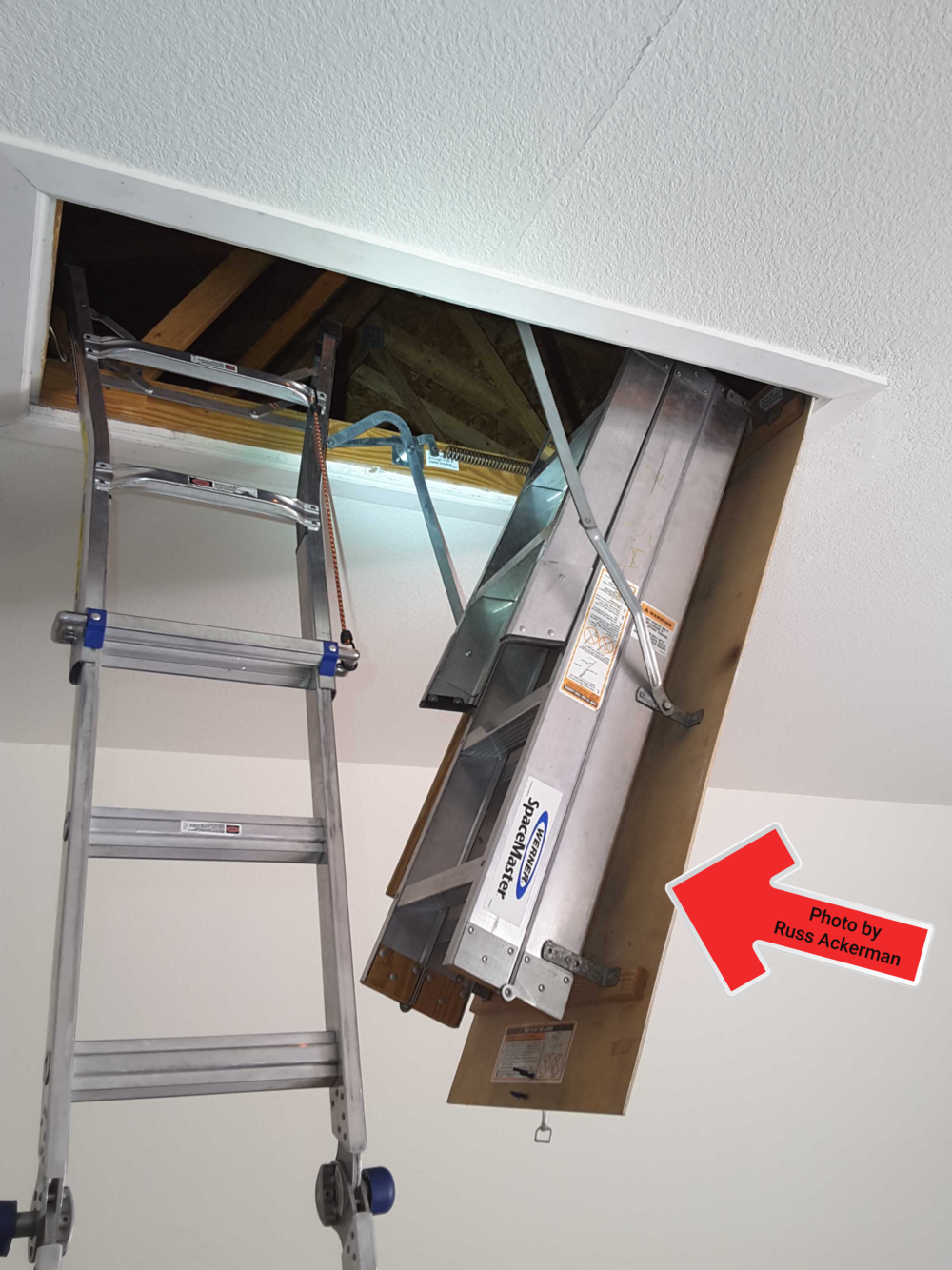 """Pull down attic ladders in a garage usually have a thin 1/4"""" plywood cover which does not meet fire separation barrier requirements."""