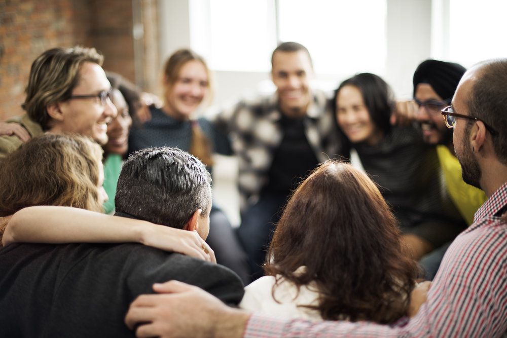 Woman smiling in center of group.jpg