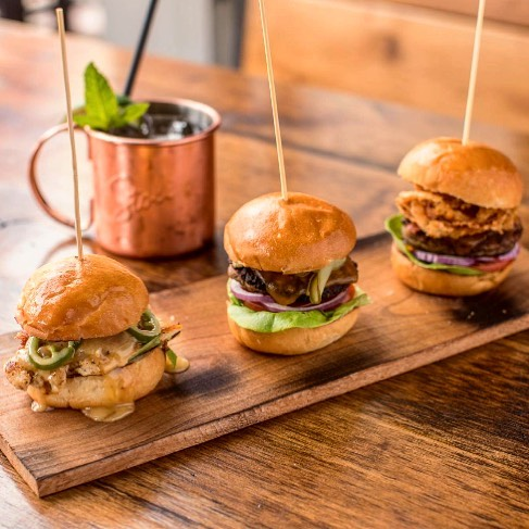 The cure for Monday blues = $1 Sliders and $5 Mules at American Junkie!