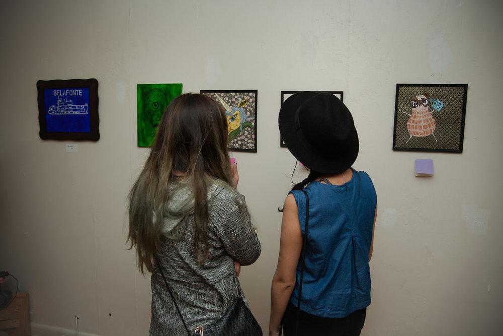 Attendees enjoy art at a FoodGore Pop-Up show