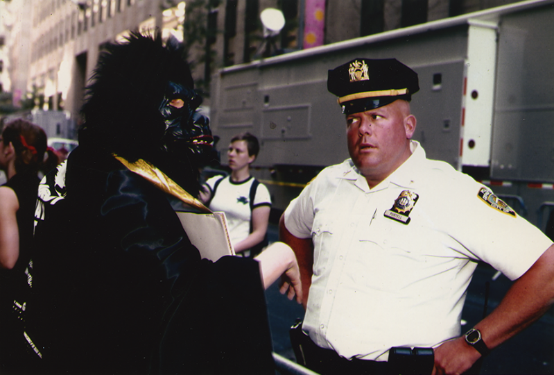 A masked Guerrilla Girl confronts a police officer during a TONY Awards protest. (Photo by Donna Kaz).