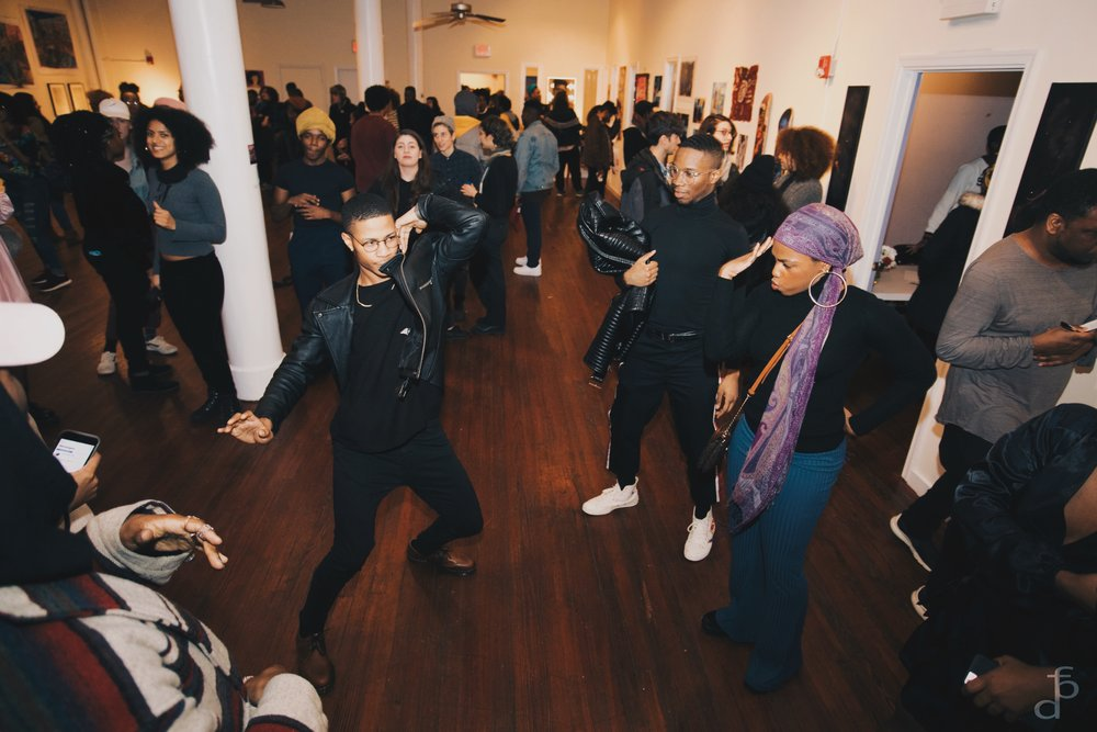 Compulsive burst of dancing!   Right with jacket: Participating Poet Antonio Wright