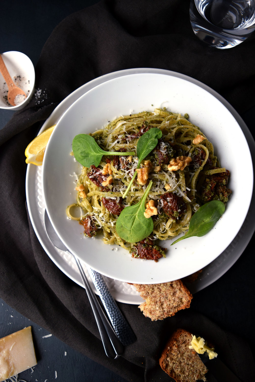 Spaghetti with spinach and walnut pesto.