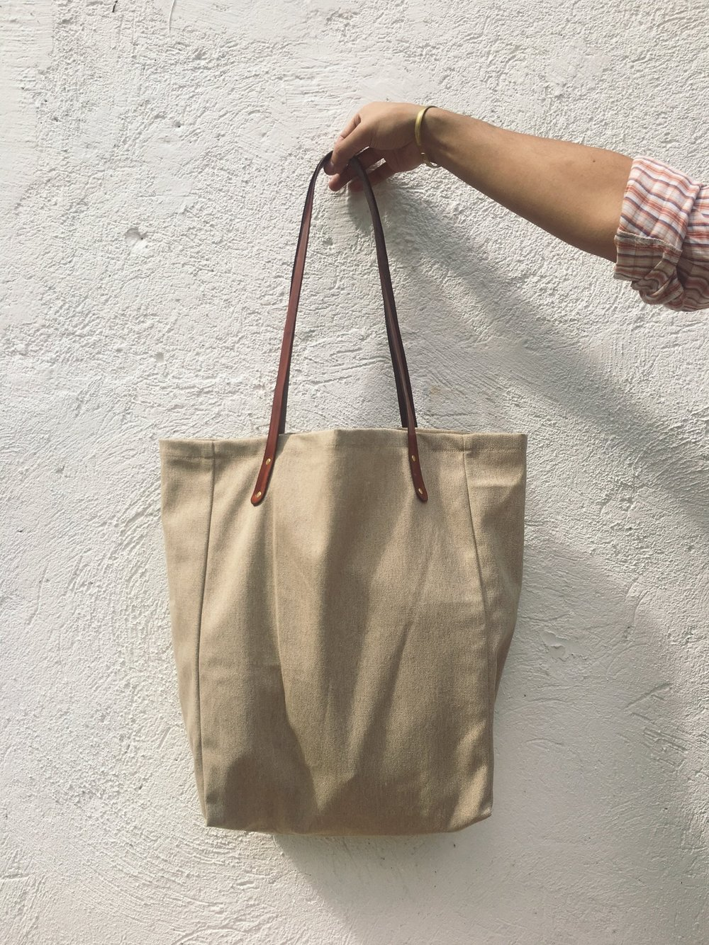 DON PEDRO TOTE BAG - we just dropped a limited run of canvas tote bags with hand dyed veg tan leather straps and solid brass hardware.